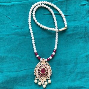 Pearl and ruby necklace with rhinestones pendant